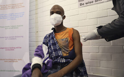 A vaccine volunteer receives an injection at the Chris Hani Baragwanath hospital in Soweto, Johannesburg, June 24, 2020v (AP Photo/Siphiwe Sibeko)