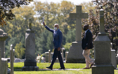 Democratic presidential candidate former Vice President Joe Biden waves to media as he leaves St. Joseph On the Brandywine Catholic Church after attending Mass in Wilmington, Delaware, Sept. 6, 2020. (AP Photo/Carolyn Kaster)