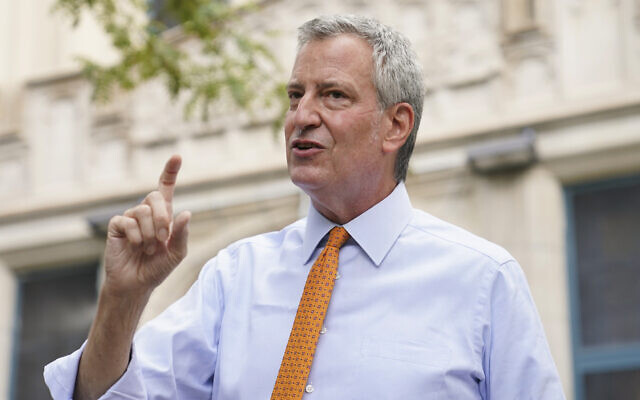 New York Mayor Bill de Blasio speaks to reporters after visiting New Bridges Elementary School in the Brooklyn borough of New York to observe pandemic-related safety procedures, August 19, 2020. (AP Photo/John Minchillo, File)