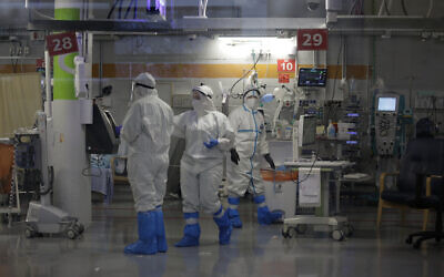 Medical professionals in full protective equipment work in in the critical care coronavirus unit, which was built in an underground parking garage at Sheba Medical center in Ramat Gan, September 30, 2020, amid a spike in COVID-19 cases. (AP Photo/Maya Alleruzzo)