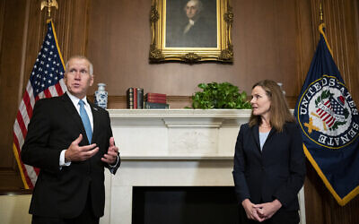 Sen. Thom Tillis meets with Judge Amy Coney Barrett, President Donald Trump's nominee to the Supreme Court at the US Capitol, Sept. 30, 2020, in Washington. (Bill Clark/Pool via AP)