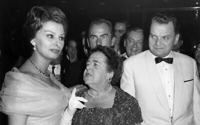 Picture taken on July 4, 1959 shows Italian actress Sophia Loren, American journalist Elsa Maxwell and festival director Dr. Alfred Bauer, right, at the festival in the Palais am Funkturm in Berlin. (Konrad Giehr/dpa via AP, file)