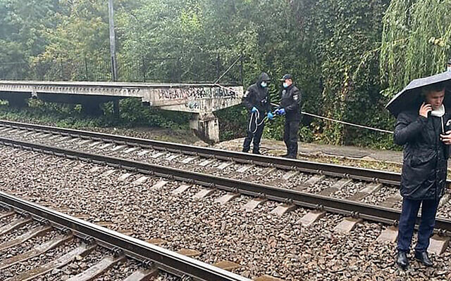 Investigators work at the scene where a US embassy employee who was found with unconscious with a head injury near railways tracks in Kyiv, Ukraine, September 30, 2020. She later died of her injuries. (Ministry of Internal Affairs of Ukraine via AP)