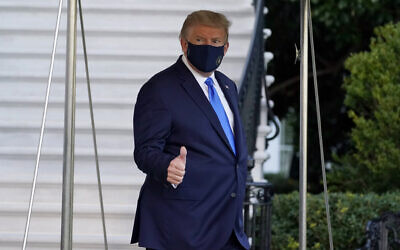 US President Donald Trump gives a thumbs-up as he leaves the White House to go to Walter Reed National Military Medical Center after he tested positive for COVID-19, in Washington, October 2, 2020. (Alex Brandon/AP)