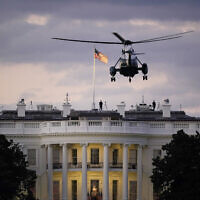 US President Donald Trump arrives back at the White House aboard Marine One, October 5, 2020, in Washington, after being treated for COVID-19 at Walter Reed National Military Medical Center (AP Photo/J. Scott Applewhite)