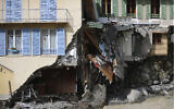 A damaged house is pictured after floods in Saint-Martin-Vesubie, southeastern France, Oct.6, 2020 (AP Photo/Daniel Cole)
