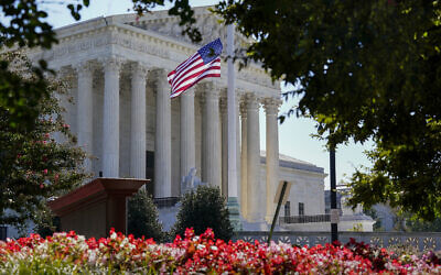 The US Supreme Court is seen in Washington, Tuesday, Oct. 6, 2020, as the justices continue arguments in a new term without their colleague, the late Justice Ruth Bader Ginsburg. (AP Photo/J. Scott Applewhite)
