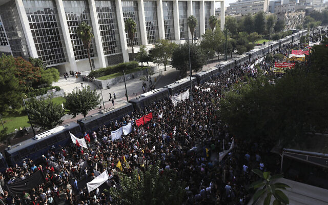 Thousands of people gather for a protest outside a court as it delivered a landmark verdict in the marathon, five-year-long trial against the country's extreme right-wing Golden Dawn party,  in Athens, October 7, 2020. (Yorgos Karahalis/AP)
