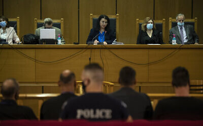 Judge Maria Lepenioti, center, delivers a verdict ruling that the far-right Golden Dawn party is operating as a criminal organization, in a court in Athens, Greece, October 7, 2020. (AP Photo/Petros Giannakouris)