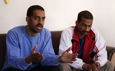 """Alexanda Amon Kotey, left, and El Shafee Elsheikh, who were allegedly among four British jihadis who made up a brutal Islamic State cell dubbed """"The Beatles,"""" at a security center in Kobani, Syria,  March 30, 2019. (AP Photo/Hussein Malla)"""