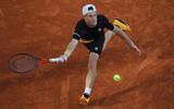 Argentina's Diego Schwartzman plays a shot against Spain's Rafael Nadal in the semifinal match of the French Open tennis tournament at the Roland Garros stadium in Paris, France, Oct. 9, 2020. (AP Photo/Christophe Ena)