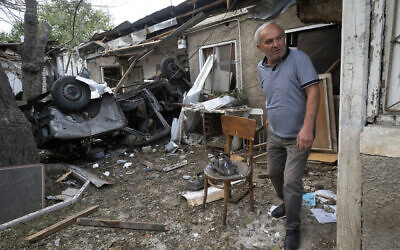 A man walks in the yard of a house destroyed by shelling by Azerbaijan's artillery during a military conflict in Stepanakert, the separatist region of Nagorno-Karabakh, Oct. 9, 2020 (AP Photo)