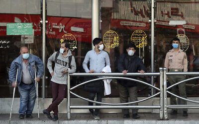 People wear protective face masks to help prevent the spread of the coronavirus in downtown Tehran, Iran, October 11, 2020. (Ebrahim Noroozi/AP)