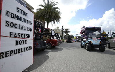 Residents show their support for President Donald Trump before a campaign rally appearance by Vice President Mike Pence, Saturday, Oct. 10, 2020, in The Villages, Fla. (AP Photo/Phelan M. Ebenhack)