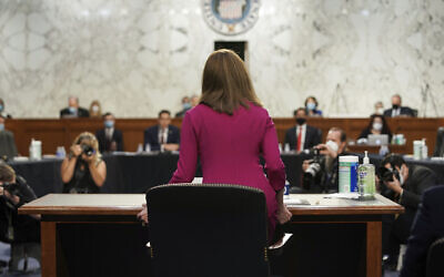 US Supreme Court nominee Amy Coney Barrett arrives for her Senate Judiciary Committee confirmation hearing before the Senate Judiciary Committee on Capitol Hill, in Washington, October 12, 2020. (Greg Nash/Pool via AP)