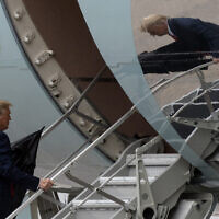 US President Donald Trump boards Air Force One, Monday, Oct. 12, 2020, at Andrews Air Force Base, Md. Trump is en route to Florida. (AP Photo/Alex Brandon)