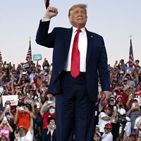 US President Donald Trump arrives for a campaign rally at Orlando Sanford International Airport, Oct. 12, 2020, in Sanford, Florida. (AP Photo/Evan Vucci)