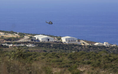 A helicopter flies over a base of the UN peacekeeping force, in the town of Naqoura, Lebanon, October 14, 2020, during the first round of talks between Lebanese and Israeli delegations on the countries' maritime border. (AP/Bilal Hussein)