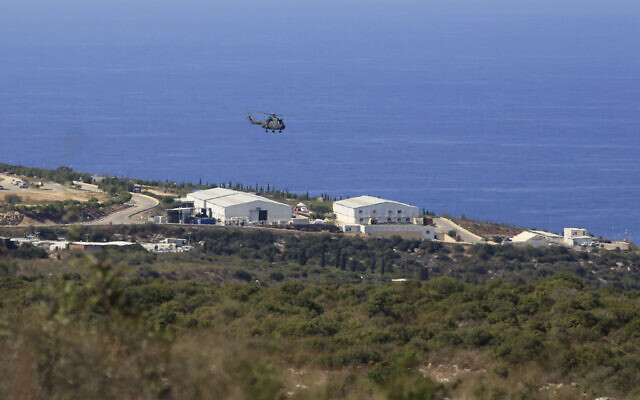 A helicopter flies over a base of the UN peacekeeping force, in the town of Naqoura, Lebanon, October 14, 2020, during the first round of talks between Lebanese and Israeli delegations on the. (AP/Bilal Hussein)