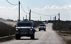 UN peacekeeping military vehicles patrol near the post where the indirect talks between Israel and Lebanon were being held in the southern Lebanese border town of Naqoura, Lebanon, October 14, 2020. (Bilal Hussein/AP)