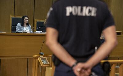 Presiding judge Maria Lepenioti reads the sentences during the Golden Dawn trial, in Athens, October 14, 2020. (AP Photo/Petros Giannakouris)