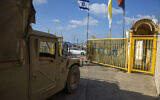 An Israeli soldier opens the gates of the Rosh Hanikra border crossing between Israel and Lebanon in northern Israel, October 14, 2020. (Ariel Schalit/AP)