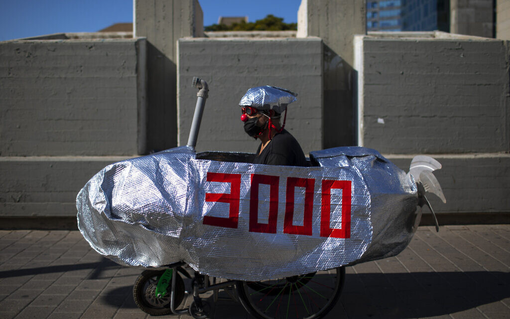 A man rides in a mock submarine during a protest against Prime Minister Benjamin Netanyahu in Tel Aviv, Israel, Wednesday, Oct. 14, 2020. (AP/Oded Balilty)