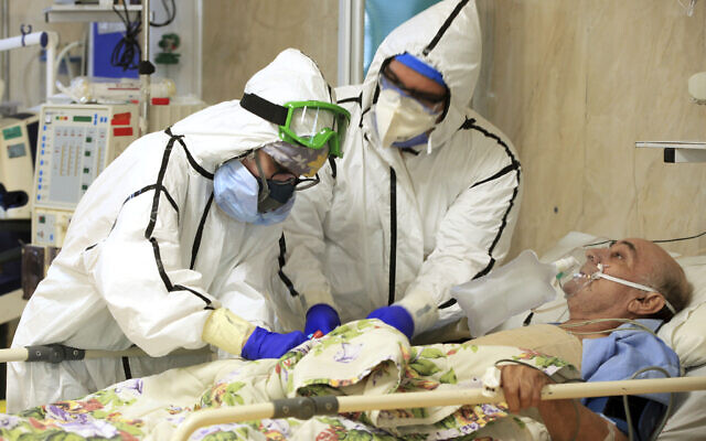 Medics tend to a COVID-19 patient at the Shohadaye Tajrish Hospital in Tehran, Iran, October 14, 2020. (Akbar Badrkhani/Iranian Health Ministry via AP)
