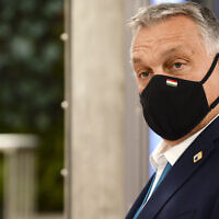 Hungary's Prime Minister Viktor Orban leaves the building during departures at the end of an EU summit in Brussels, on October 16, 2020. (Johanna Geron, Pool via AP)