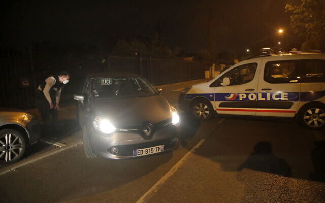 Police officers block the access after a history teacher who opened a discussion with students on caricatures of Islam's Prophet Muhammad was decapitated in a French street on Friday and police have shot the suspected killer dead, Oct. 16, 2020 in Conflans-Saint-Honorine, north of Paris. (AP Photo/Michel Euler)