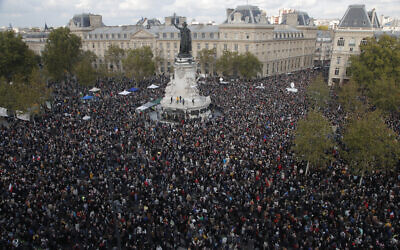 Thousands gather at Republique square during a demonstration October 18, 2020, in Paris, folliowing the behading of a history teacher in an alleged Islamist terror attack (AP Photo/Michel Euler)