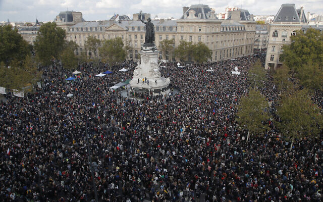 Hundreds of people gather at Republique square during a demonstration October 18, 2020, in Paris (AP Photo/Michel Euler)