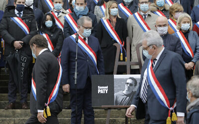French lawmakers gather to pay homage to slain teacher Samuel Paty on October 20, 2020 on the steps of the National Assembly in Paris. (AP/Lewis Joly)