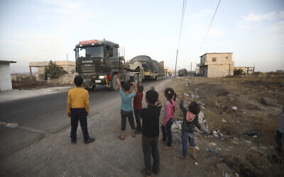A Turkish military convoy drives through the village of Urum al-Jawz, in Idlib province, Syria, October 20, 2020. (AP/Ghaith Alsayed)