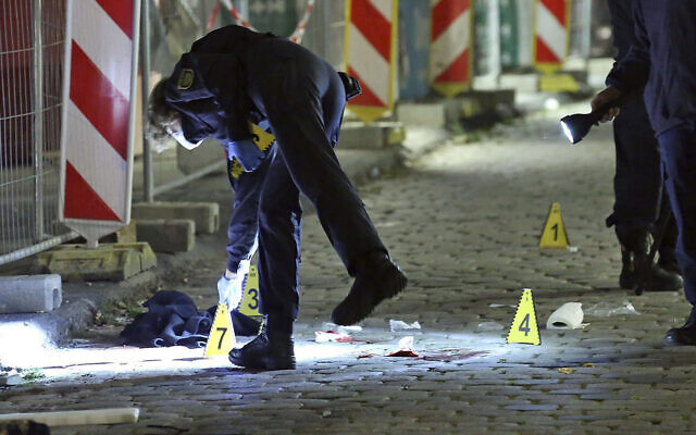 Criminal experts investigate a crime scene in Dresden, Germany, on October 5, 2020,  after two people were killed in a knife attack. (Roland Halkasch/dpa via AP, file)