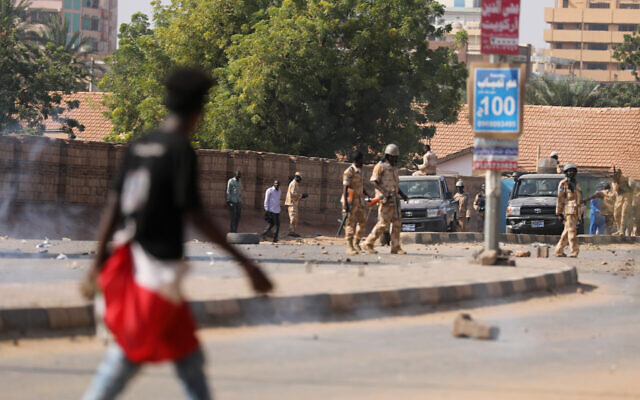 Illustrative: Security forces prevent demonstrators from reaching the Sudanese army headquarters, in Khartoum, Sudan, October 21, 2020. (AP Photo/Marwan Ali)