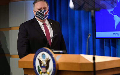US Secretary of State Mike Pompeo arrives to speak at a news conference at the State Department in Washington on October 21, 2020. (Nicholas Kamm/Pool via AP)