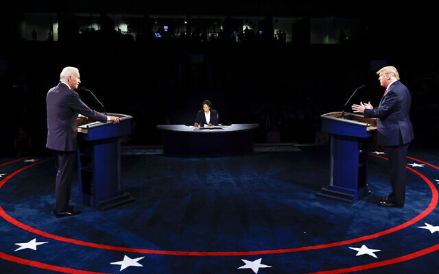 US President Donald Trump and Democratic presidential candidate former Vice President Joe Biden participate in the final presidential debate at Belmont University, Thursday, Oct. 22, 2020, in Nashville, Tenn. (Jim Bourg/Pool via AP)