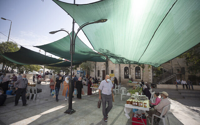 "Palestinian shoppers walk through Soq al-Fallahat, which means ""women farmer bazar,"" in the West Bank city of Ramallah, October 24, 2020. (AP Photo/Nasser Nasser)"