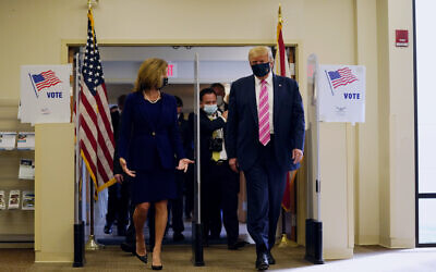 US President Donald Trump walks with Wendy Sartory Link, Supervisor of Elections for Palm Beach County, after casting his ballot for the presidential election, Saturday, Oct. 24, 2020, in West Palm Beach, Fla. (AP Photo/Evan Vucci)