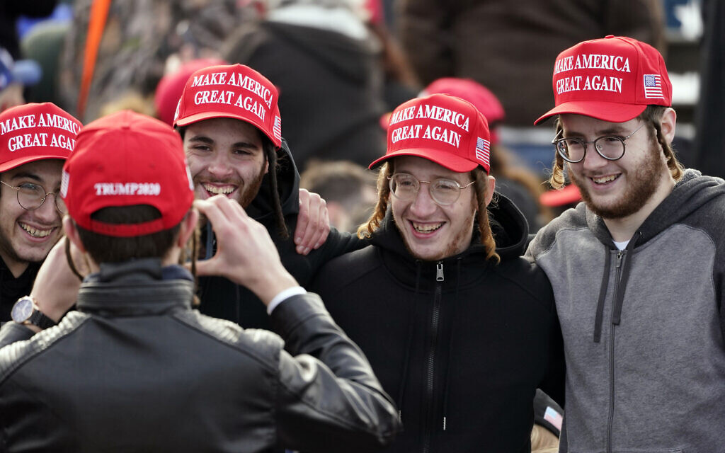 Illustrative: Supporters pose for a photo before US President Donald Trump speaks during a campaign rally at Manchester-Boston Regional Airport, October 25, 2020, in Londonderry, New Hampshire. (AP Photo/Elise Amendola)