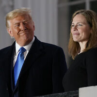 US President Donald Trump and Amy Coney Barrett stand on the Blue Room Balcony after Supreme Court Justice Clarence Thomas administered the Constitutional Oath to her on the South Lawn of the White House White House in Washington, October 26, 2020 (AP Photo/Patrick Semansky)