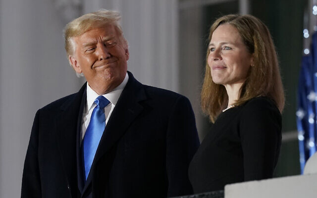 Illustrative: US President Donald Trump and Amy Coney Barrett stand on the Blue Room Balcony after Supreme Court Justice Clarence Thomas administered the Constitutional Oath to her on the South Lawn of the White House White House in Washington, October 26, 2020. (AP Photo/Patrick Semansky)