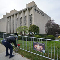 A man places flowers outside the Tree of Life synagogue in Pittsburgh on October 27, 2020, the second anniversary of the shooting at the synagogue, that killed 11 worshippers. (Gene J. Puskar/AP)
