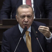 Turkey's President Recep Tayyip Erdogan addresses his ruling party lawmakers at the parliament, in Ankara, Turkey, October 28, 2020.  (AP Photo)