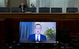 Facebook CEO Mark Zuckerberg appears on a screen as he speaks remotely during a hearing before the Senate Commerce Committee on Capitol Hill, October 28, 2020, in Washington (Michael Reynolds/Pool via AP)