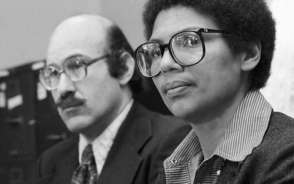 In this April 24, 1980, file photo, Olympic bronze medalist Anita DeFrantz, right, and Ira Glasser, executive director of the American Civil Liberties Union, announce a lawsuit in New York by athletes against the US Olympic Committee for depriving Americans the opportunity to compete in the Moscow Games. (AP Photo/Burnett, File)