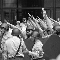 Helmeted members of the National Socialist Party of America give the Fascist salute during a rally in downtown Chicago, June 24, 1978. (AP)