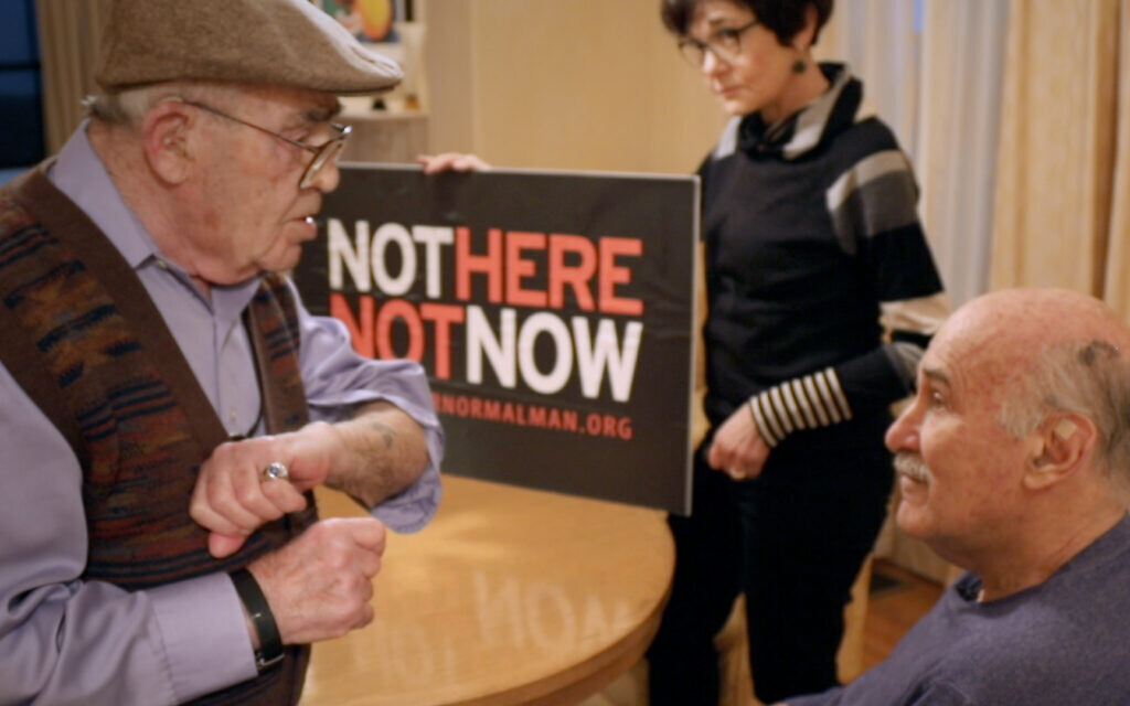 Holocaust survivor Ben Stern, left, shows Ira Glasser his concentration camp tattoo in this still from 'Mighty Ira.' (Courtesy)