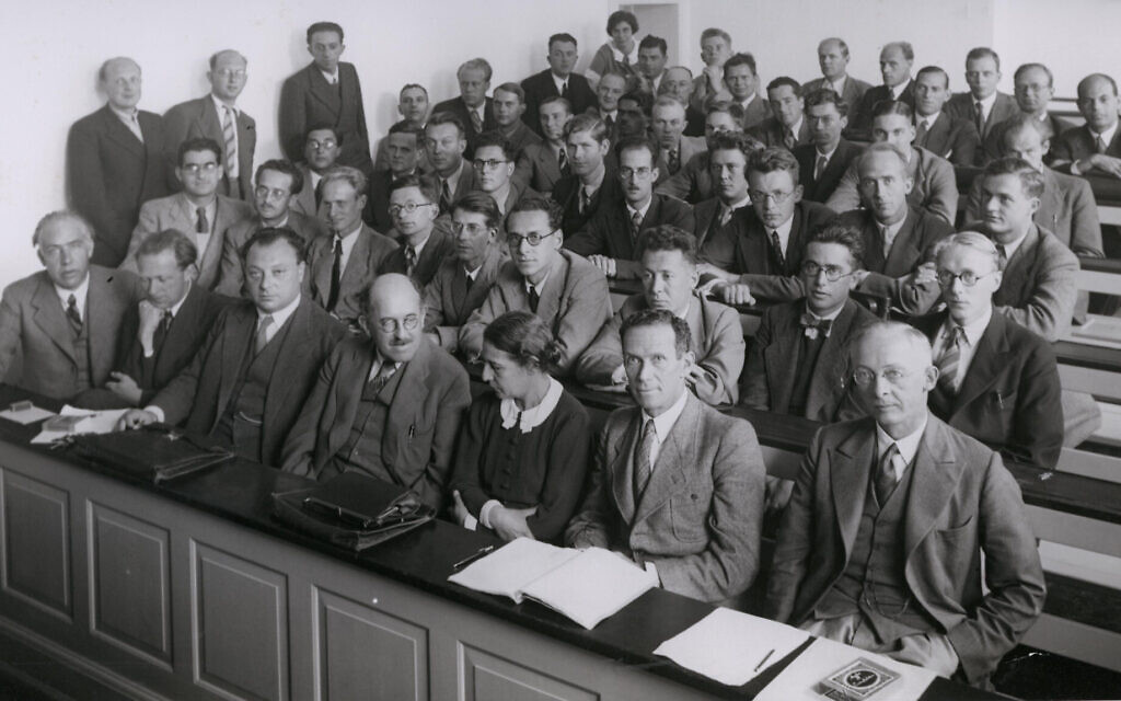 At a conference in 1937, Meitner shares the front row with (left to right) Niels Bohr, Werner Heisenberg, Wolfgang Pauli, Otto Stern and Rudolf Ladenburg; Hilde Levi is the only other woman in the room. (Friedrich Hund via WikimediaCommons)
